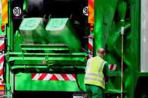 Truck and Operator Collecting Wheelie bins